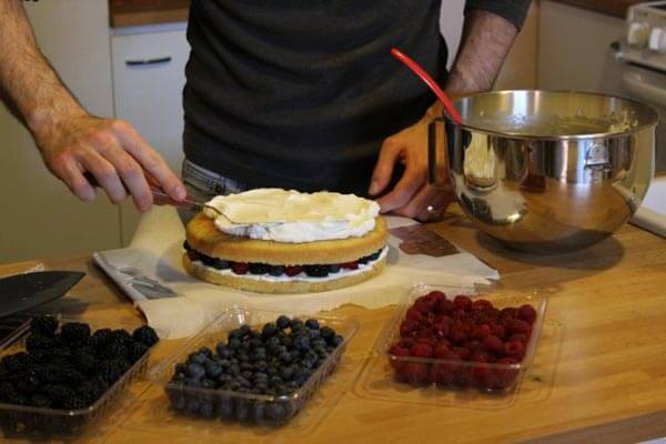 Assembling the berry cake