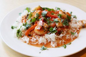 Shrimp stew with coconut milk, tomatoes and cilantro