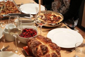 Thanksgiving meal with dressing, potato gratin, cranberry sauce, and homemade challah bread
