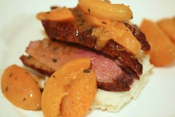 Duck breast with apricot-tarragon sauce and masked potatoes
