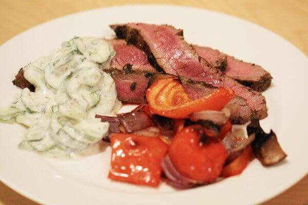 Grilled flank steak with cucumber-yogurt sauce and roasted red peppers, red onions and portobello mushrooms