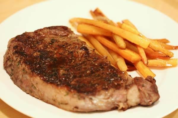Pan-seared ribeye steak with pan-roasted carrots