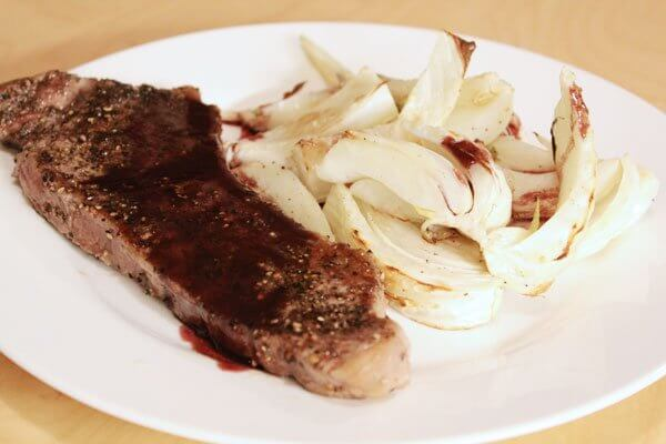 New York strip steak au poivre with roasted fennel