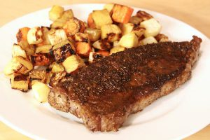 Spice-rubbed New York strip steak with roasted root vegetables