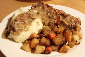 Spicy southwestern meatloaf with sherry-mushroom gravy, mashed potatoes and roasted root vegetables
