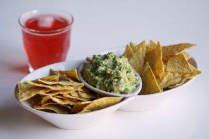 Cilantro-lime guacamole with tortilla chips