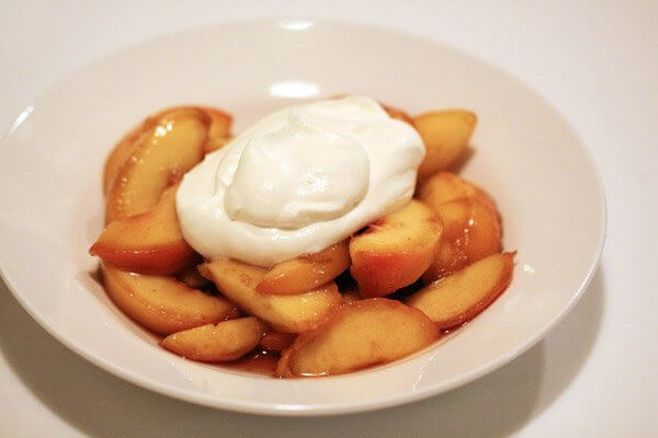 Marinated peaches with honey whipped cream
