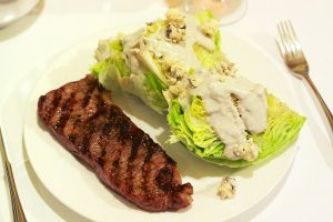 Spice-rubbed New York steak, served with iceberg wedges with blue cheese buttermilk dressing