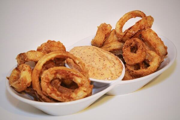 Buttermilk-battered onions rings and calamari with spicy aioli