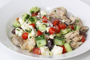 Village-style Greek salad with chicken, cucumber, cherry tomatoes, feta cheese, olives and lemon-mint vinaigrette