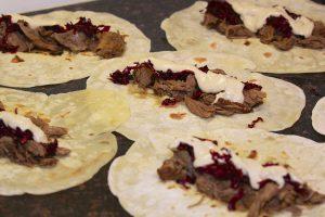 Assembling the lamb shawarma