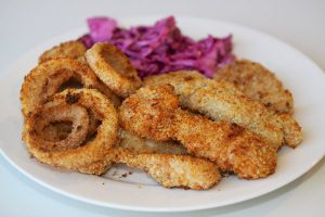 Chicken fingers with baked onion rings and coleslaw