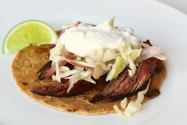 Flank steak tacos with spicy slaw