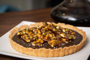 Chocolate tart with salted caramelized pistachios