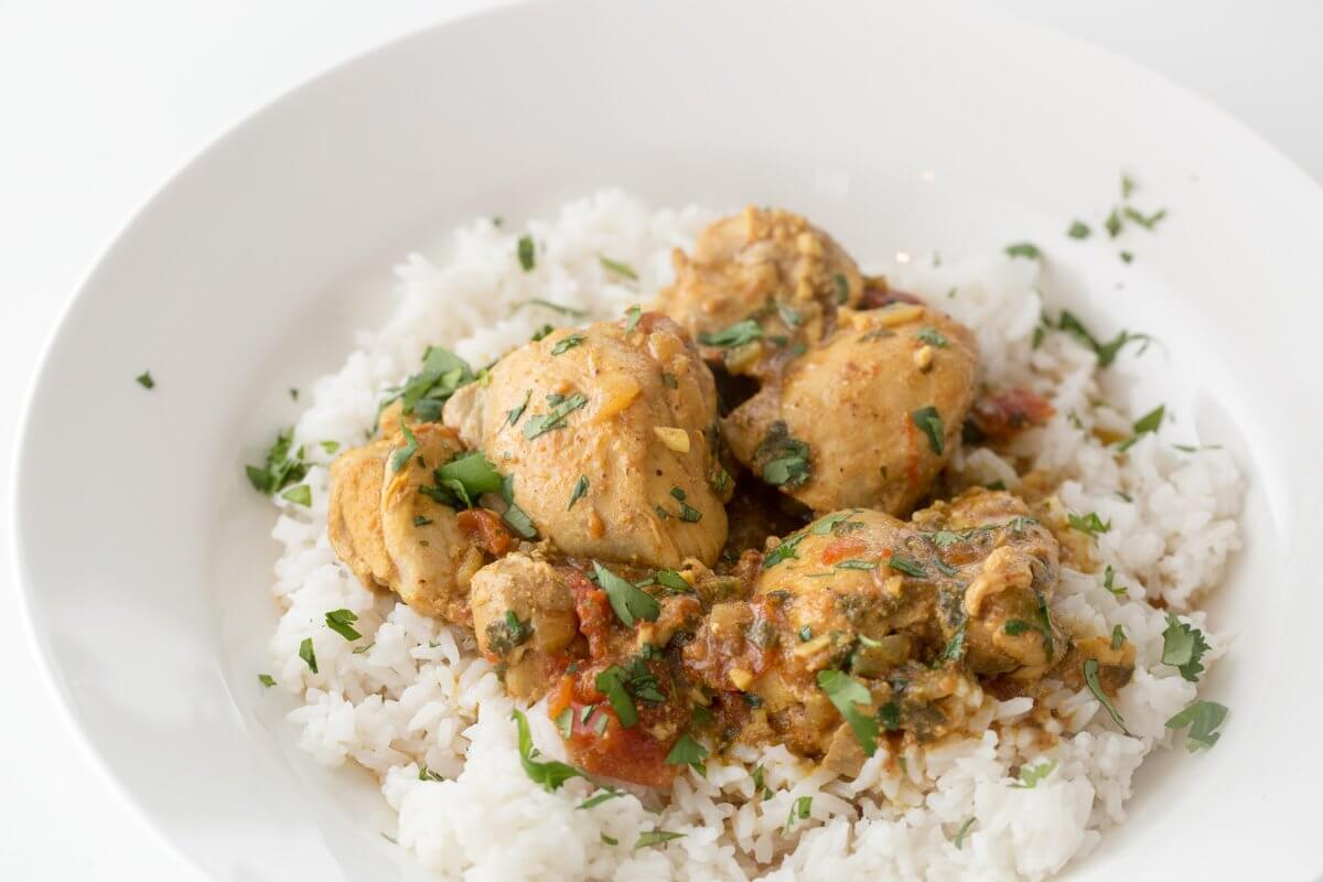 Sindhi chicken curry with tomatoes and cilantro, served on white rice