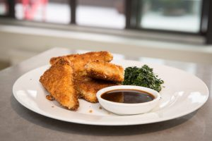 Crispy fried breaded tofu with hoisin dipping sauce and spinach