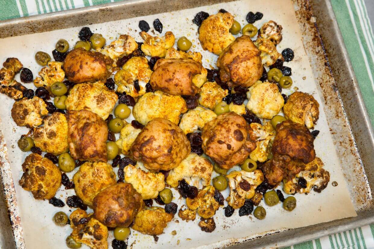Curried chicken thighs with cauliflower, dried cranberries and olives