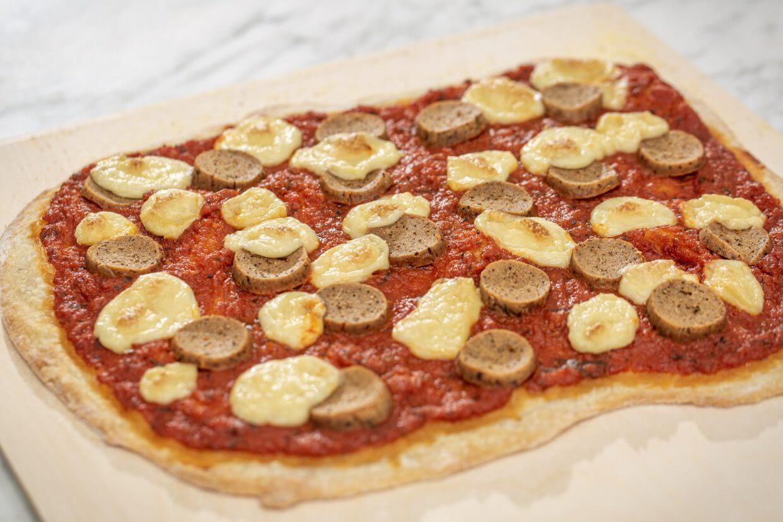 Vegan pizza with seitan Italian sausage and cashew mozzarella cheese