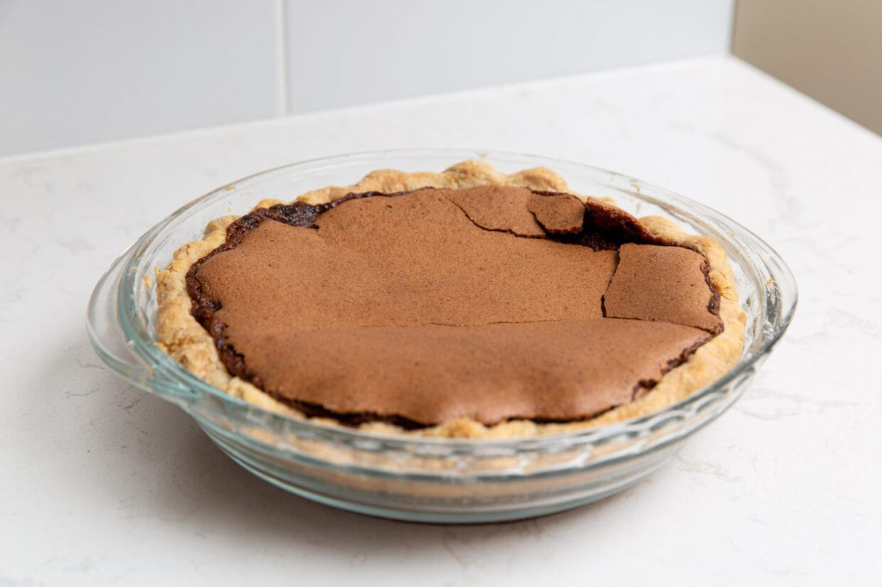 Chocolate chess pie on a white marble countertop